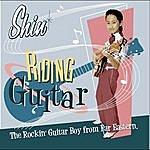 Shin Riding Guitar