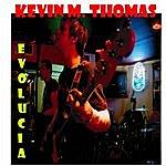Kevin M. Thomas Evolucia