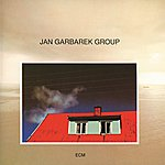 Jan Garbarek Photo With Blue Sky, White Cloud, Wires, Windows And A Red R