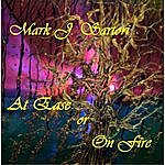 Mark Sartori At Ease Or On Fire