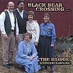Black Bear Crossing The Bridge