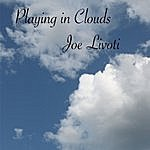 Joe Livoti Playing In Clouds